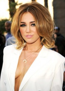 1337692707_miley-cyrus-article-380x528