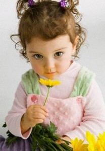 Toddler with Yellow Flowers