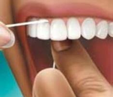 como-utilizar-o-fio-dental-corretamente