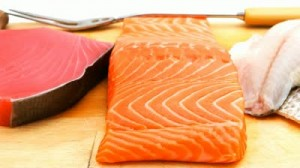 stock-footage-pieces-of-salmon-red-tuna-and-sole-fish-on-wooden-plate-isolated-on-white-background