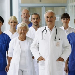 Doctors and interns standing side by side --- Image by © HBSS/Corbis