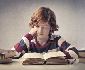 11490020-concentrated-child-reading-a-book
